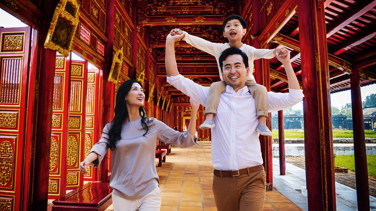 Parents and son enjoying their visit in a temple; image used for HSBC Visa Platinum Credit Card page