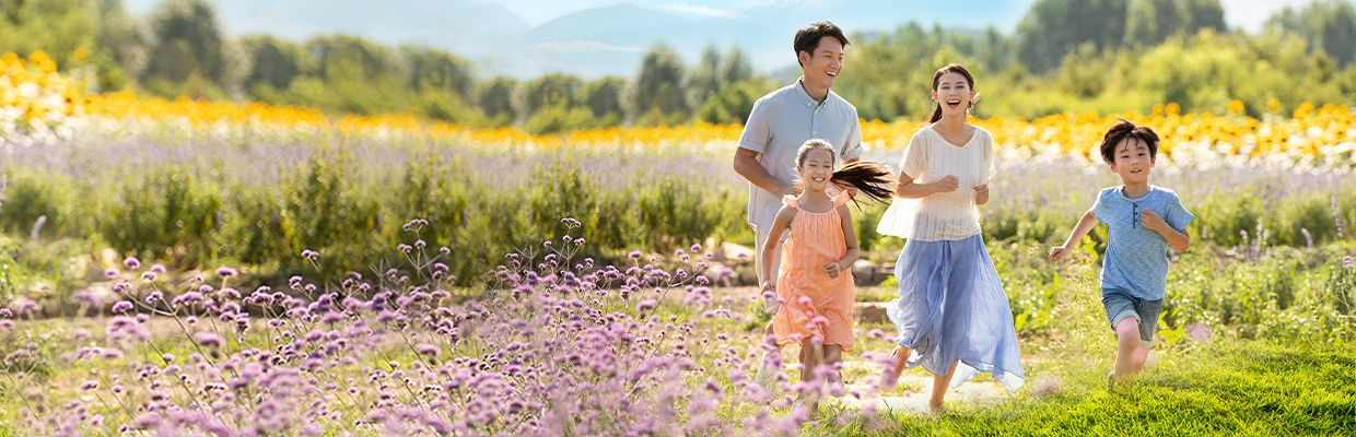 Happy young family in flower field; image used for HSBC Vietnam Life Insurance Offer page