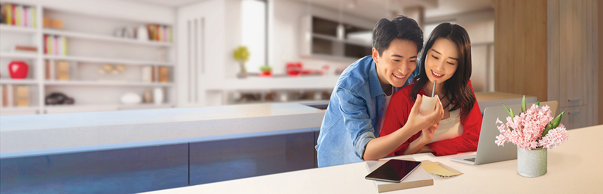 a young couple checking bills in front of a laptop; image used for HSBC VN Bill Payment page